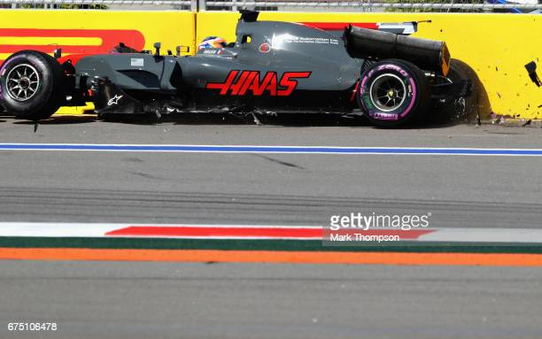 Romain Grosjean of France driving the Haas F1 Team HaasFerrari VF17 Ferrari in the track barrier after crashing at the start during the Formula One...