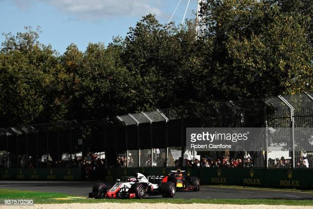 Romain Grosjean of France driving the Haas F1 Team VF-18 Ferrari leads Daniel Ricciardo of Australia driving the Aston Martin Red Bull Racing RB14...