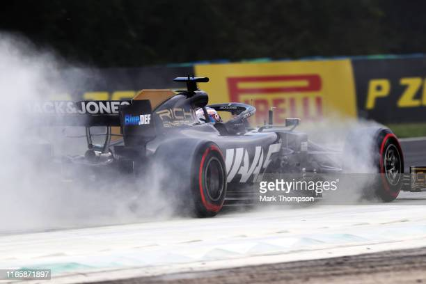 Romain Grosjean of France driving the Haas F1 Team VF-19 Ferrari kicks up dust on track during final practice for the F1 Grand Prix of Hungary at...