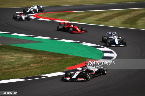 Romain Grosjean of France driving the Haas F1 Team VF-20 Ferrari leads George Russell of Great Britain driving the Williams Racing FW43 Mercedes...