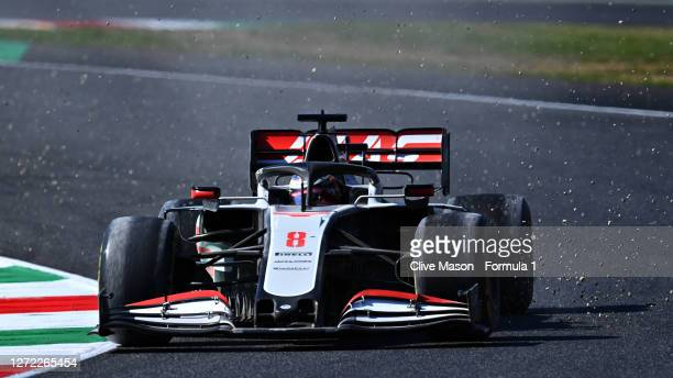 Romain Grosjean of France driving the Haas F1 Team VF-20 Ferrari throws gravel from his tyres after running wide at the start during the F1 Grand...