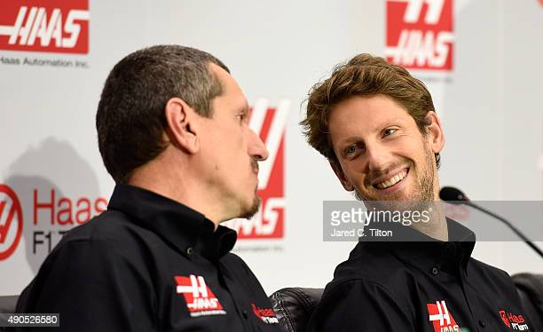 Romain Grosjean of France looks on as Gunther Steiner team principal of Haas F1 Team speaks during a press conference as Haas F1 Team announces...