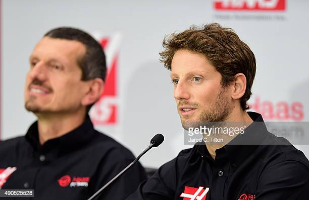 Romain Grosjean of France speaks as Gunther Steiner team principal of Haas F1 Team looks on during a press conference as Haas F1 Team announces...