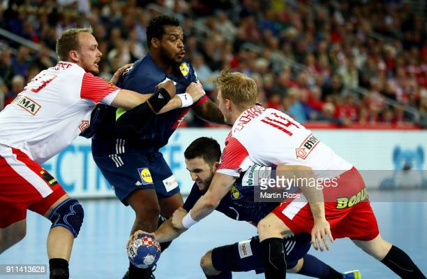 Romain Lagarde of France challenges Anders Zachariassen of Denmark during the Men's Handball European Championship 3rd place match between France and...