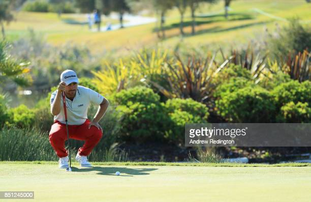 Romain Langasque of France lines up a putt on the 18th green during day two of the Portugal Masters at Dom Pedro Victoria Golf Club on September 22...