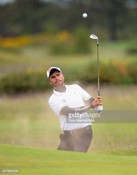 Romain Langasque of France play out of a bunker on the 13th green during The Amateur Championship 2015 Day Four at Carnoustie Golf Club on June 18...