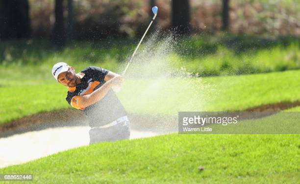 Romain Langasque of France plays his second shot from a bunker on the 9th hole during day two of the BMW PGA Championship at Wentworth on May 26 2017...