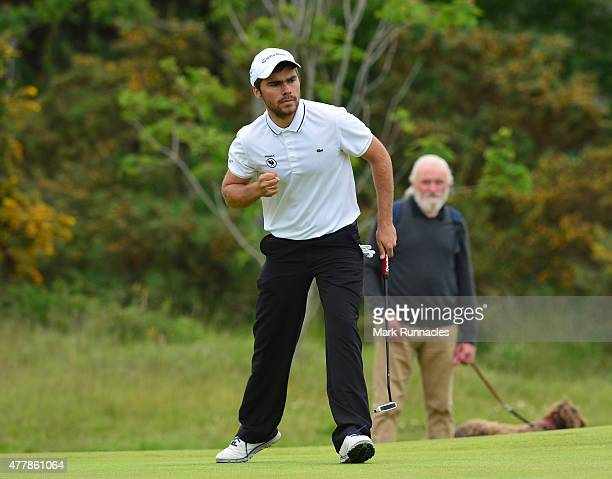 Romain Langasque of France reacts after sinking a long putt on the 10th green during day Six of the Amateur Championship 2015 at Carnoustie Golf...