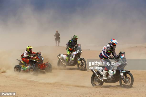 Romain Leloup of France and Team Repar'stores rides a KTM 450 RallyE bike in the Classe 21 Super Production ahead of Santiago Bernal of colombia and...