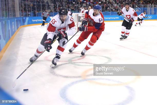 Romain Loeffel of Switzerland skates with the puck against Jiri Sekac of the Czech Republic during the Men's Ice Hockey Preliminary Round Group A...