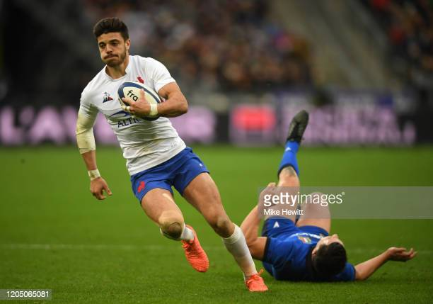 Romain Ntamack of France runs past Luca Morisi of Italy on the way to scoring his sides fourth try during the 2020 Guinness Six Nations match between...
