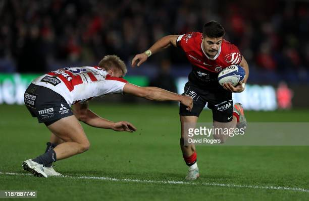 Romain Ntamack of Toulouse is tackled by Chris Harris during the Heineken Champions Cup Round 1 match between Gloucester Rugby and Toulouse at...