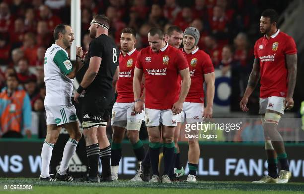 Romain Poite the referee talks to All Black captain Kieran Read after he changes a decision when he orginally had awarded a penalty to the All Blacks...