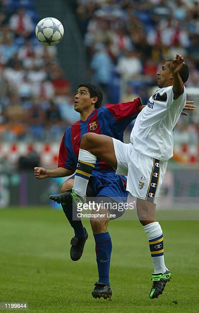 Romain Riquelme of Barcelona battles with Leite Ribeiro Adriano of Parma during the first match between Barcelona and Parma in the Amsterdam...