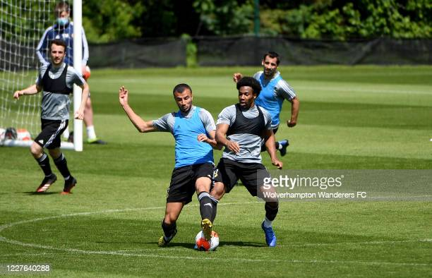 Romain Saiss and Adama Traore of Wolverhampton Wanderers take part in the isolated training session during the Coronavirus COVID19 lockdown at Sir...