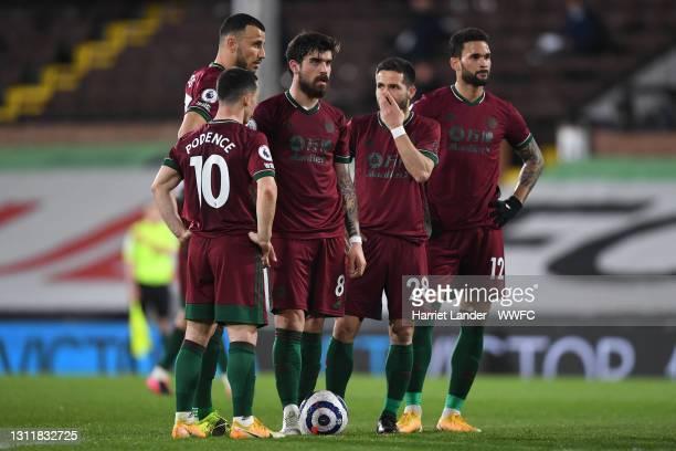 Romain Saiss, Daniel Podence, Ruben Neves, Joao Moutinho and Willian Jose of Wolverhampton Wanderers speak as they prepare to take a free kick during...
