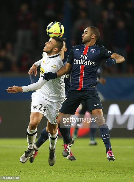 Romain Saiss of Angers and Lucas Moura of PSG in action during the French Ligue 1 match between Paris SaintGermain and SCO Angers at Parc des Princes...