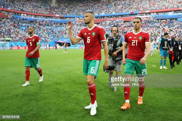 Romain Saiss of Morocco and Sofyan Amrabat of Morocco look dejected as the leave the pitch following their sides defeat in the 2018 FIFA World Cup...