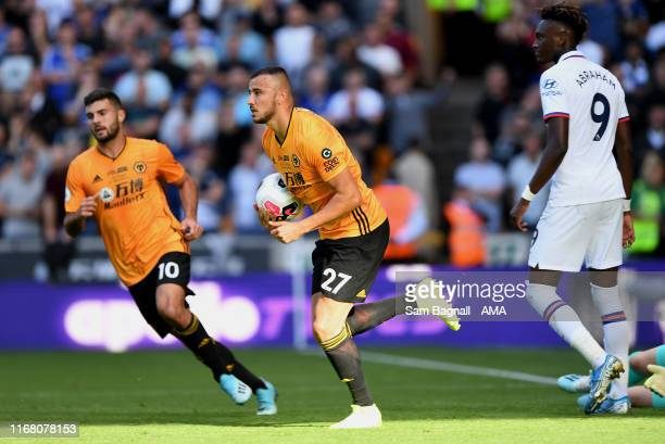 Romain Saiss of Wolverhampton Wanderers celebrates after scoring a goal to make it 14 during the Premier League match between Wolverhampton Wanderers...