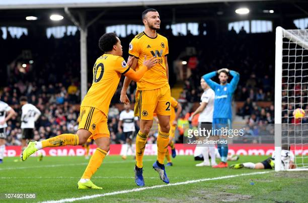 Romain Saiss of Wolverhampton Wanderers celebrates after scoring his team's first goal with Helder Costa of Wolverhampton Wanderers during the...