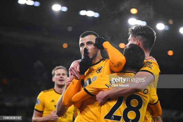 Romain Saiss of Wolverhampton Wanderers celebrates after scoring his team's first goal with his team mates during the Premier League match between...
