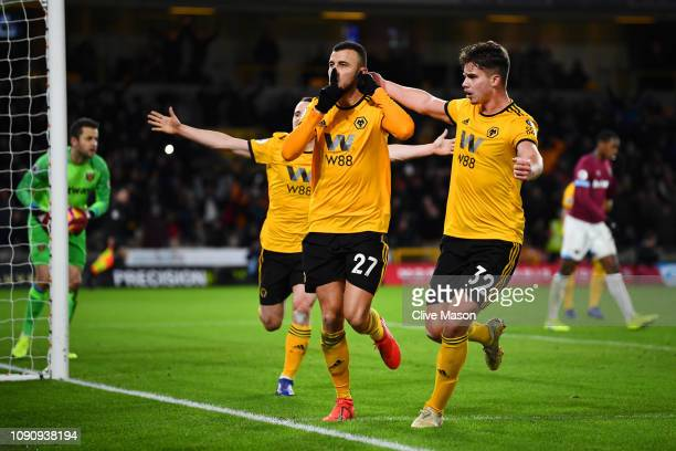 Romain Saiss of Wolverhampton Wanderers celebrates after scoring his team's first goal with Leander Dendoncker of Wolverhampton anderers during the...