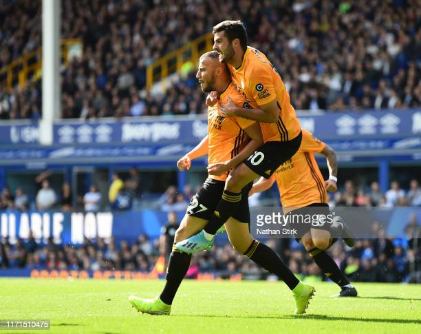 Romain Saiss of Wolverhampton Wanderers celebrates after scoring his team's first goal during the Premier League match between Everton FC and...