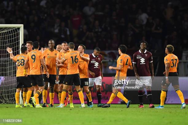 Romain Saiss of Wolverhampton Wanderers celebrates after scoring the opening goal with teammates during the UEFA Europa League Playoffs 1st Leg match...