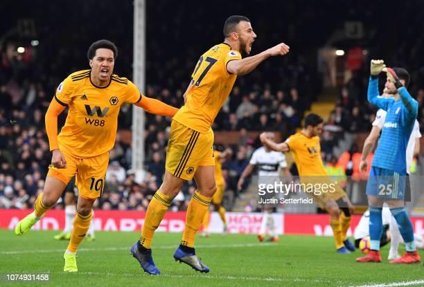 Romain Saiss of Wolverhampton Wanderers celebrates scoring his team's first goal with Helder Costa of Wolverhampton Wanderers during the Premier...