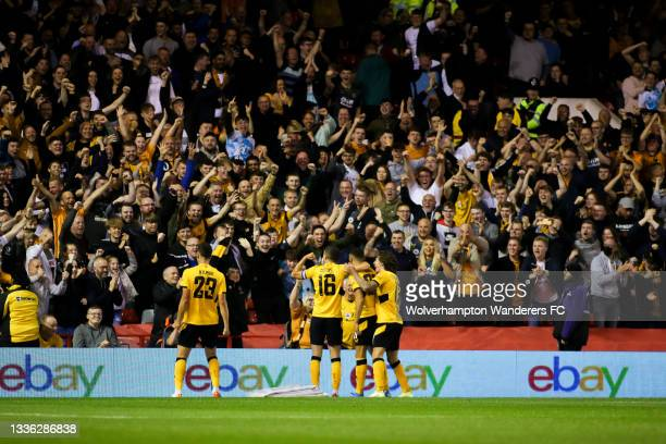 Romain Saiss of Wolverhampton Wanderers celebrates scoring his team's first goal with teammates during the Carabao Cup Second Round match between...