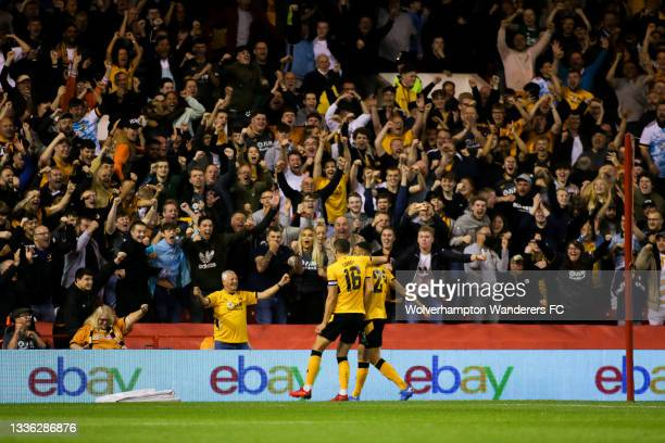 Romain Saiss of Wolverhampton Wanderers celebrates scoring his team's first goal with Conor Coady during the Carabao Cup Second Round match between...