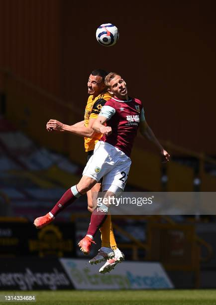 Romain Saiss of Wolverhampton Wanderers competes for a header with Matej Vydra of Burnley during the Premier League match between Wolverhampton...