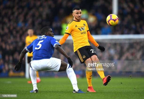 Romain Saiss of Wolverhampton Wanderers is challenged by Kurt Zouma of Everton during the Premier League match between Everton FC and Wolverhampton...