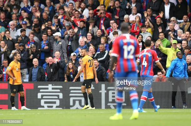 Romain Saiss of Wolverhampton Wanderers leaves the pitch following a red card during the Premier League match between Crystal Palace and...