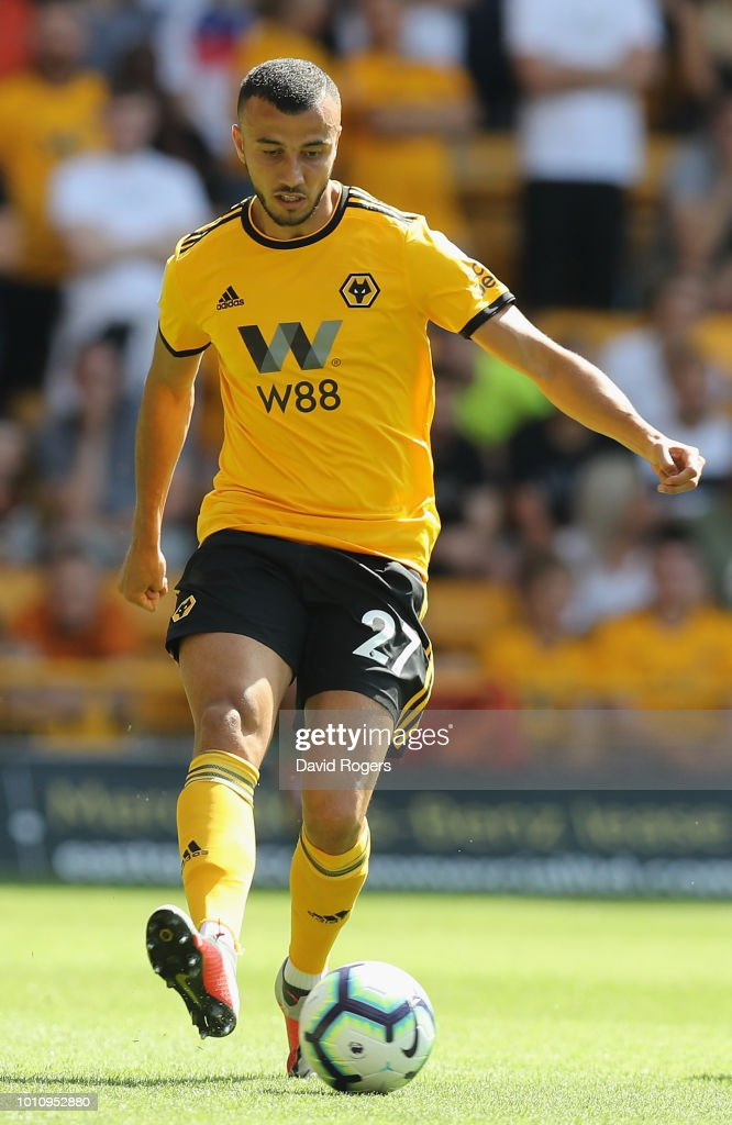 Romain Saiss of Wolverhampton Wanderers passes the ball during the pre-season friendly match between Wolverhampton Wanderers and Villareal at Molineux on August 4, 2018 in Wolverhampton, England.