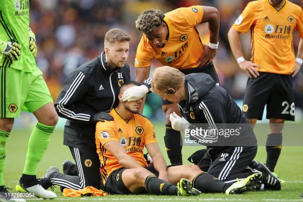 Romain Saiss of Wolverhampton Wanderers receives medical treatment during the Premier League match between Wolverhampton Wanderers and Watford FC at...