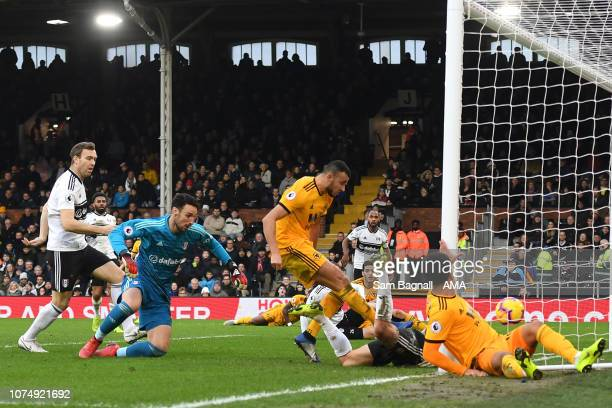 Romain Saiss of Wolverhampton Wanderers scores a goal to make it 11 during the Premier League match between Fulham FC and Wolverhampton Wanderers at...