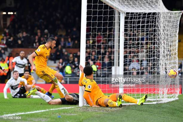 Romain Saiss of Wolverhampton Wanderers scores his team's first goal during the Premier League match between Fulham FC and Wolverhampton Wanderers at...