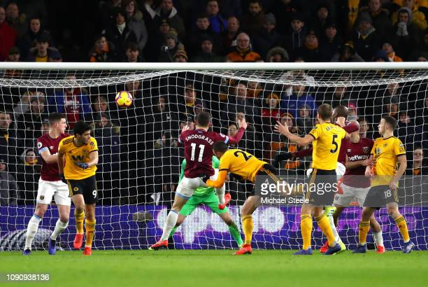 Romain Saiss of Wolverhampton Wanderers scores his team's first goal during the Premier League match between Wolverhampton Wanderers and West Ham...