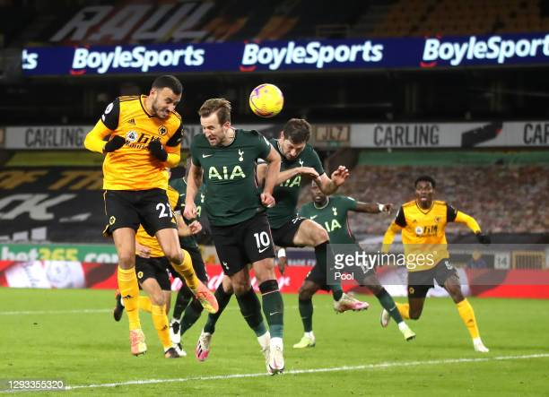 Romain Saiss of Wolverhampton Wanderers scores their team's first goal during the Premier League match between Wolverhampton Wanderers and Tottenham...