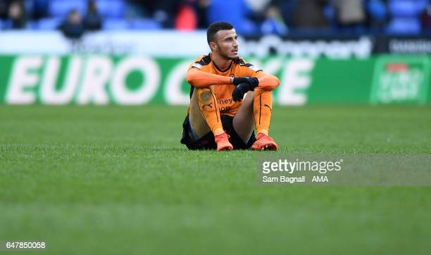 Romain Saiss of Wolverhampton Wanderers sits dejected at full time during the Sky Bet Championship match between Reading and Wolverhampton Wanderers...