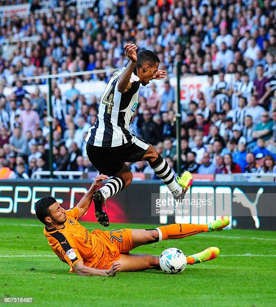 Romain Saiss of Wolverhampton Wanderers slides in to intercept the ball from Isaac Hayden of Newcastle United during the Sky Bet Championship match...