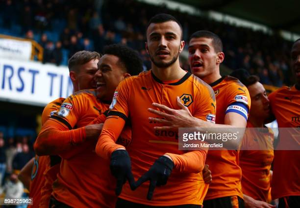 Romain Saiss of Wolves celebrates scoring his sides second goal during the Sky Bet Championship match between Millwall and Wolverhampton at The Den...