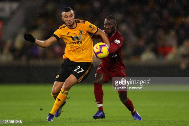 Romain Saiss of Wolves holds off pressure from Naby Kieta of Liverpool during the Premier League match between Wolverhampton Wanderers and Liverpool...