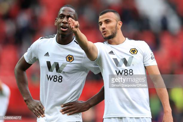Romain Saiss of Wolves points something out to teammate Willy Boly of Wolves after the Premier League match between Manchester United and...