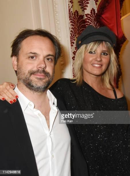 "Romain Sardou and singer Kym Thiriot attend ""Sardou Regards"" Bastien Kossek's Book Launch at Hotel Raphael on April 15, 2019 in Paris, France."
