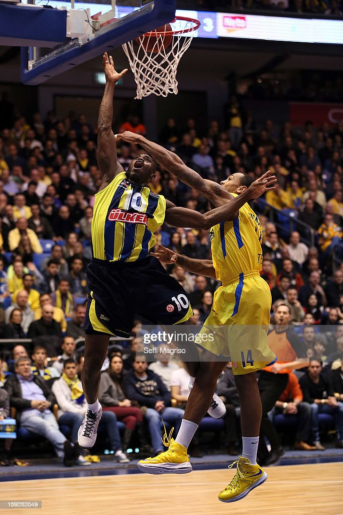 Romain Sato, #10 of Fenerbahce Ulker Istanbul competes with Malcom Thomas #14 of Maccabi Electra Tel Aviv during the 2012-2013 Turkish Airlines Euroleague Top 16 Date 3 between Maccabi Electra Tel Aviv v Fenerbahce Ulker Istanbul at Nokia Arena on January 10, 2013 in Tel Aviv, Israel.