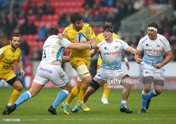 Romain Sazy of La Rochelle is tackled by Coenie Oosthuizen Ben Curry and Jono Ross of Sale Sharks during the Heineken Champions Cup Round 2 match...