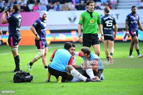 Romain Taofifenua of Toulon is knocked out by a tackle from Paul AloEmile of Stade Francais Paris during the Top 14 match between Stade Francais...