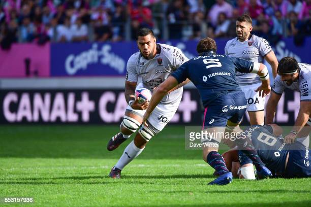 Romain Taofifenua of Toulon takes on Alexandre Flanquart of Stade Francais Paris during the Top 14 match between Stade Francais Paris and RC Toulon...